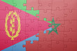 canvas print picture - puzzle with the national flag of morocco and eritrea .