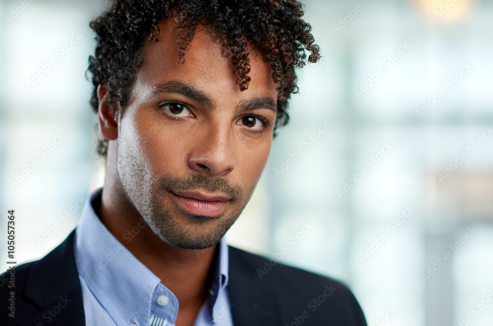 Fototapeta Horizontal headshot of an attractive african american businessman shot with shallow depth field.