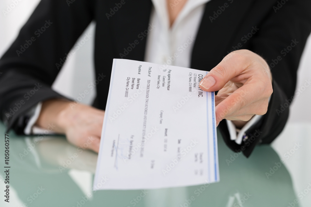 Fototapeta Businesswoman Hand Giving Cheque