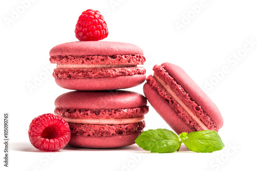 Poster Macarons Fresh macaroons with raspberries on white background