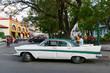 People driving a vintage car at Santiago de Cuba, Cuba