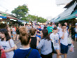 Blurred image of people shopping at Chatuchak market