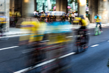 bicycle race , group of people on bikes - motion blur abstract