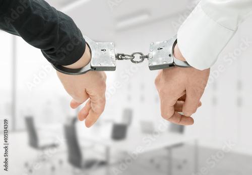 Photo  Hands in handcuffs