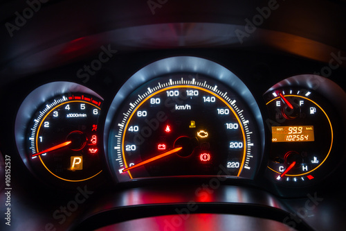 Photo  Modern car instrument dashboard panel in night time
