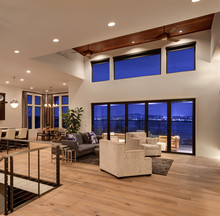 Beautiful Spacious Living Room Interior With Hardwood Floors And Gorgeous View With Water And City Lights