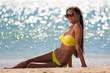 brunette woman yellow bikini sea