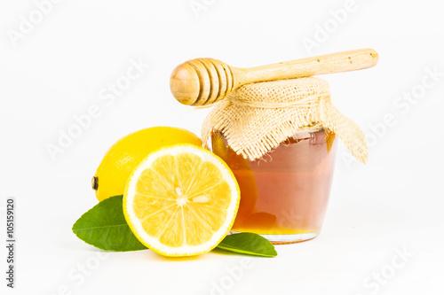 Photo  honey with lemon on white background