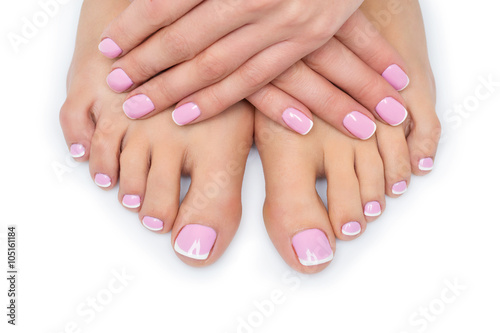 Woman hands and feet with french manicure