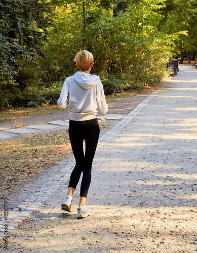 Anorexic woman running in park Canvas Print