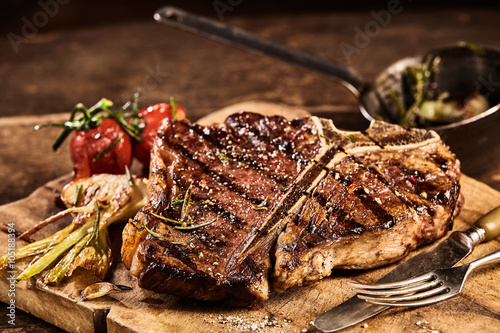Prepared grilled porterhouse steak with fork and knife