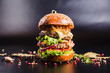 canvas print picture - Juicy delicious burger with spices on a black background