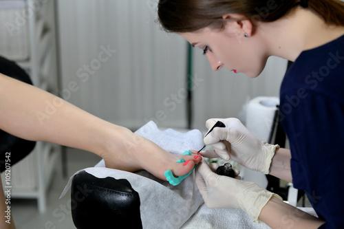 Poster Pedicure Professional pedicure master making pedicure in salon