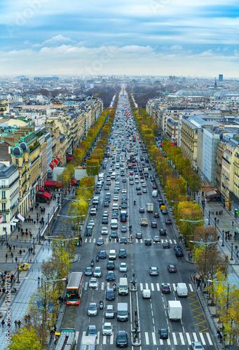 Keuken foto achterwand Seoel View of avenue des Champs Elysees in Paris from the Arc de Triomphe. Autumn. Rain. Sun.