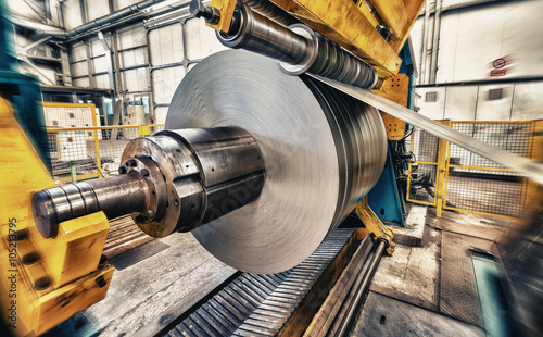 Obraz Metal coils machine. Interior of factory. Business concept - fototapety do salonu