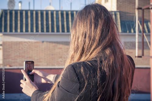 Girl taking selfie Wallpaper Mural