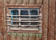 Wooden vintage window on a wooden wall
