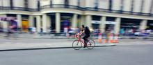 Cyclist Riding Bike Fast Throu...