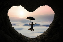 Woman Jumping Inside Cave Shaped Heart