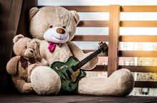 Family Of Fluffy Teddy Bears With A Guitar.