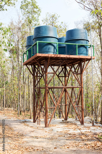 Group of water tanks set up on top of steel stand - Buy this