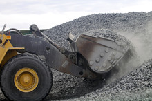Auto Loader Drawing Gravel Up Into Scoop