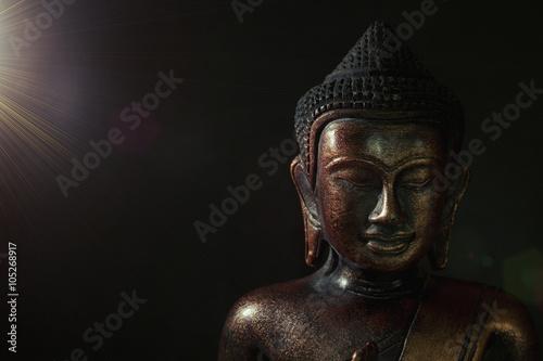 Fotografie, Obraz  Wooden bronze buddha on black background