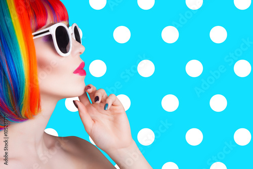 Spoed Foto op Canvas Kapsalon beautiful woman wearing colorful wig and white sunglasses