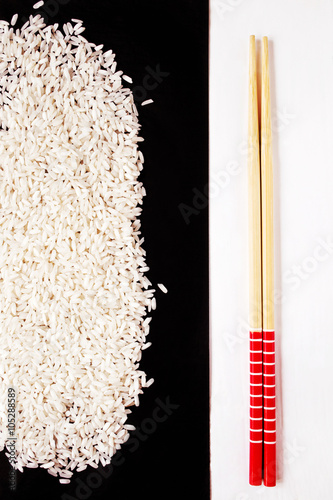 Photo  Raw rice and chopsticks before cooking
