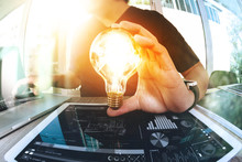 Designer Hand Showing Creative Business Strategy With Light Bulb