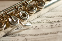 Flute On Sheet Of Music