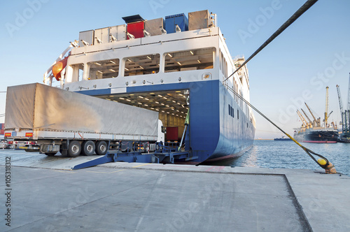 Fotografie, Obraz Ferry and Trucking Transportation - RO-RO Transport (Roll On/Roll Off)