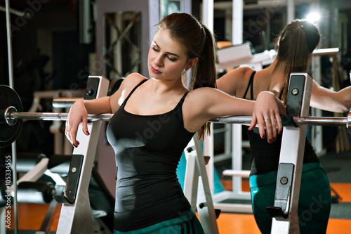 Valokuva  Fitness girl relaxing in the gym