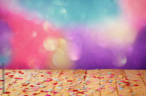 Obraz pink party whistle on wooden table with colorful confetti. vintage filtered image  - fototapety do salonu