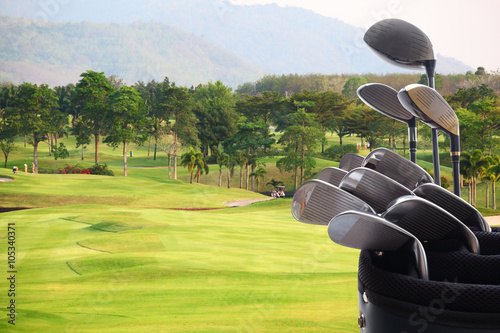 Golf clubs drivers over green field background Canvas Print