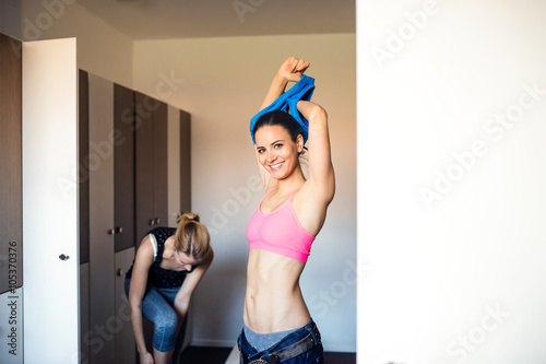 Fotografie, Obraz  Two woman changing in locker room in gym