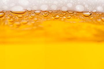 Fototapeta Na stół i biurko Beer bubbles in a mug
