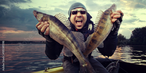 Poster Vissen Crazy angler with zander fishing trophy