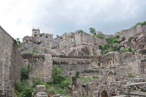 Scarred ruins of a part of the Golconda fort standing high on a rocky hill Canvas Print
