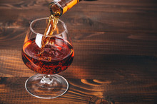 Pouring Brandy Or Cognac From ...