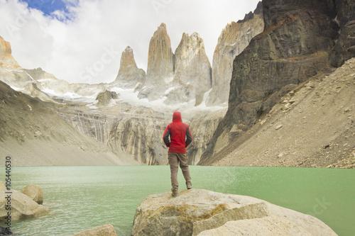 Fotografie, Obraz  man standing near lake in patagonia, torres del paine