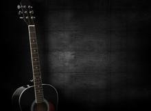 Black Acoustic Guitar On Dark ...