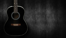 Black Acoustic Guitar On Dark ...