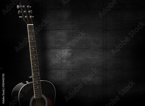 Obraz Black acoustic guitar on dark black wooden background. - fototapety do salonu