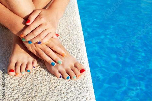 Girl relaxing beside swimming pool enjoying sun on sunny summer