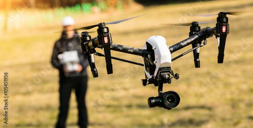 Fototapeta Man handling drone in nature obraz