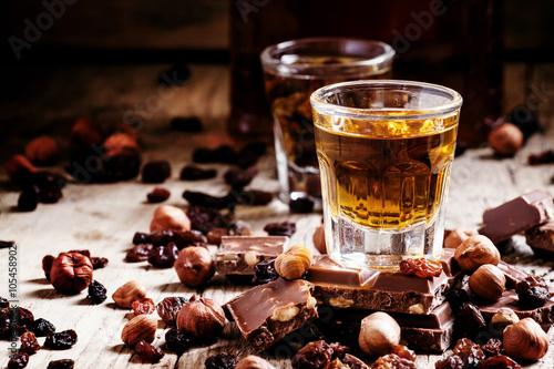Obraz na płótnie Milk chocolate with nuts and raisins with dark Jamaican rum, sel