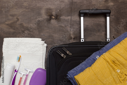 Fotografie, Obraz  Suitcase traveler and toiletries.