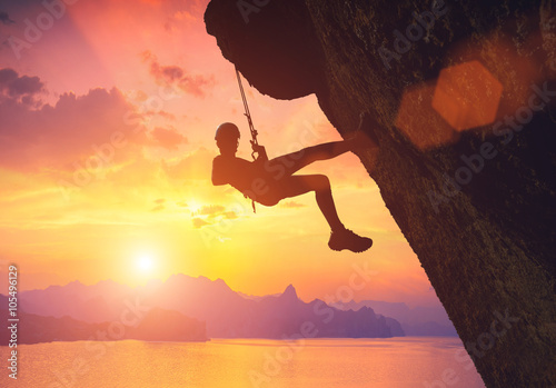 Fotografie, Obraz  Climber against red sunset