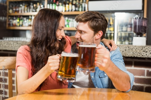 Couple toasting with beers Canvas Print